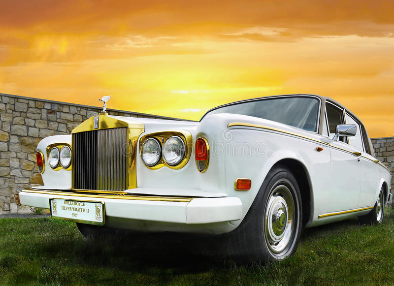 Vintage Limousine, Oldtimer Car. Luxury vintage limousine - Rolls-Roys, Silver Wraith II (1977). Oldtimer car at sunset stock photo