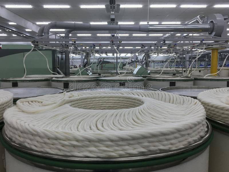 Rolls of spun cotton in a textile factory royalty free stock photography