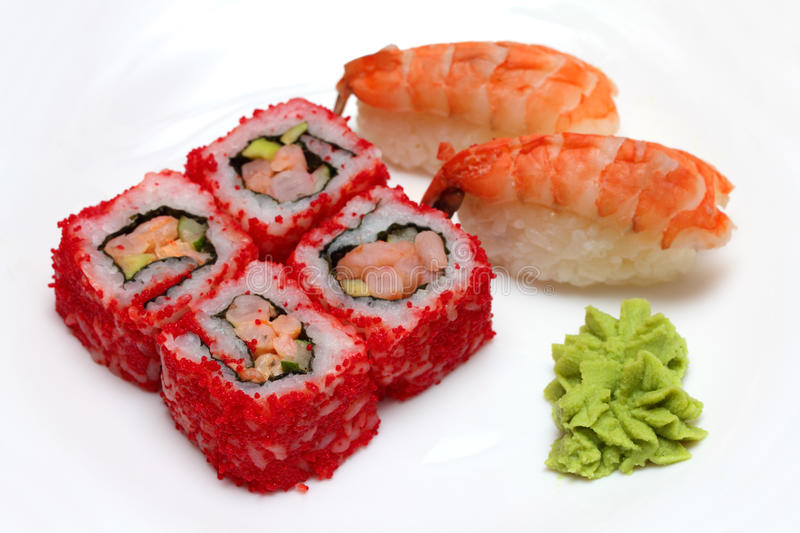 Rolls and sushi on plate royalty free stock photo