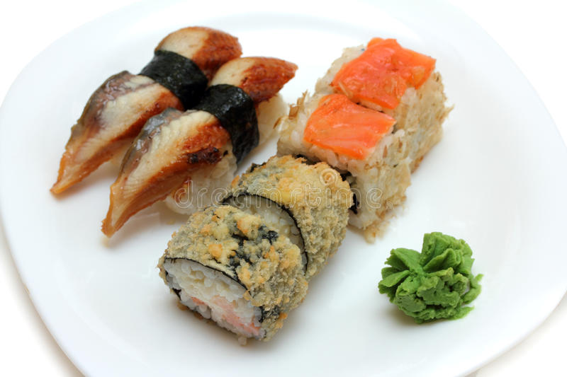 Rolls and sushi on plate royalty free stock images