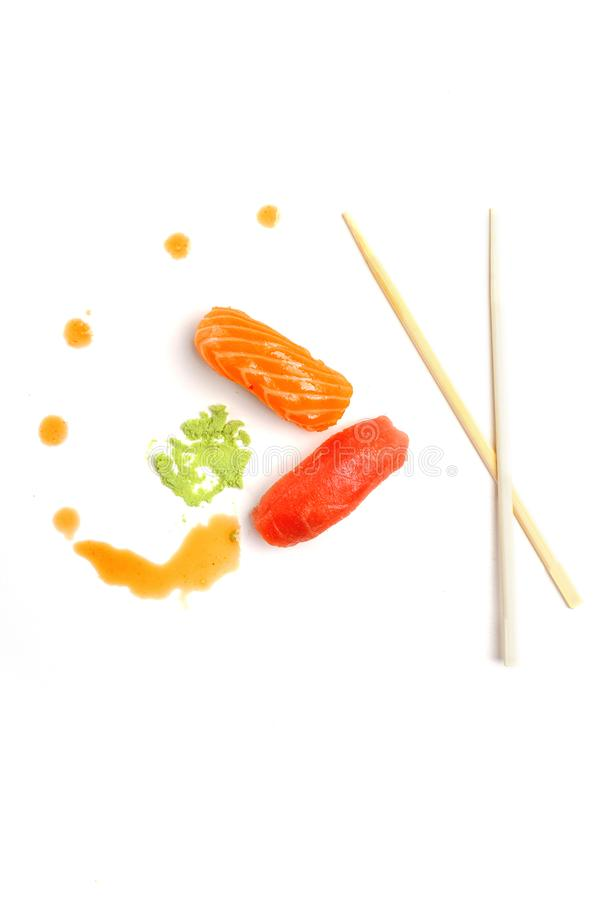 Rolls, sushi and wasabi sauce on a white background. Creative concept of fast food. Top wiev. Copy space stock photos