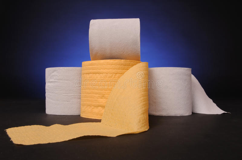 Rolls of tissue. On dark background royalty free stock images