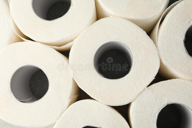Rolls of toilet paper on whole background. Top view stock photo
