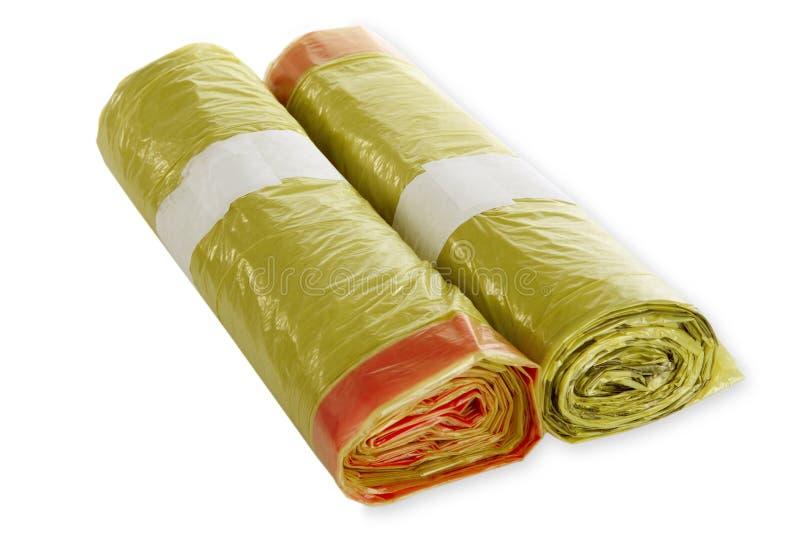 Rolls of yellow trash bags stock image