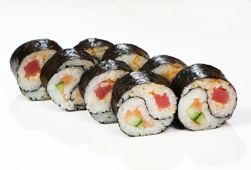 Rolls Yin Yang salmon, tuna, cucumber, spice sauce.  royalty free stock image