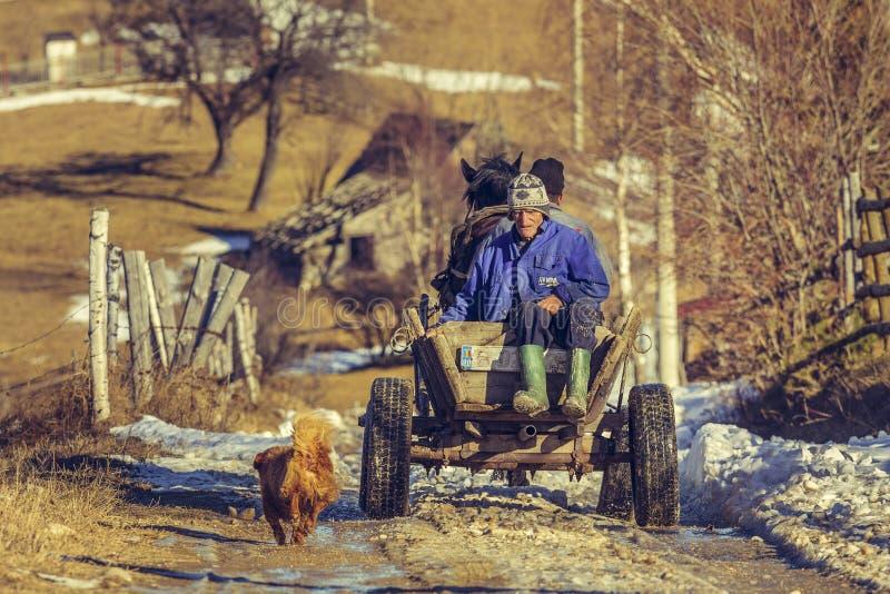 Rolnicy i końska fura fotografia stock