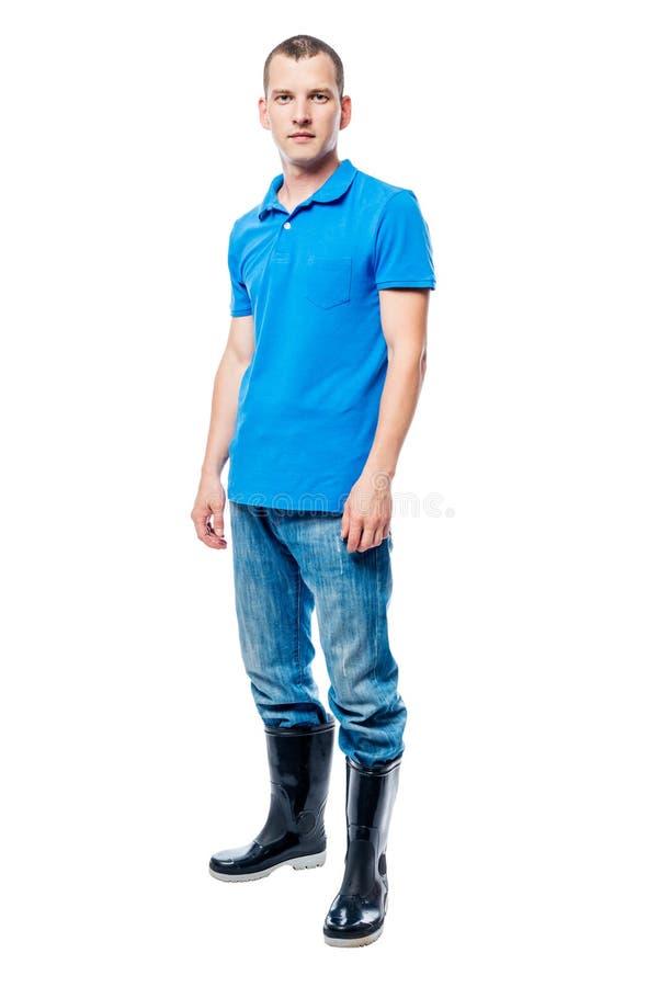 Rolnik w gumowych butach i cajgach w pełnej długości na bielu zdjęcia royalty free