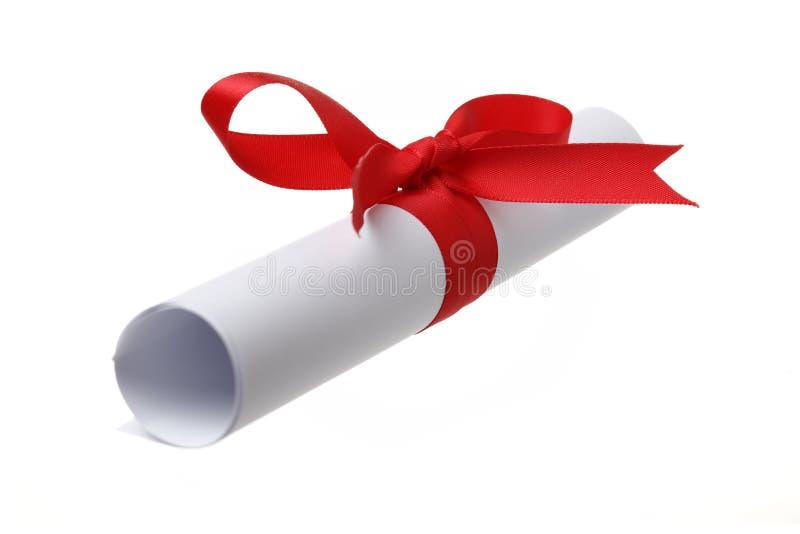 Rolo de papel e curva vermelha fotografia de stock royalty free