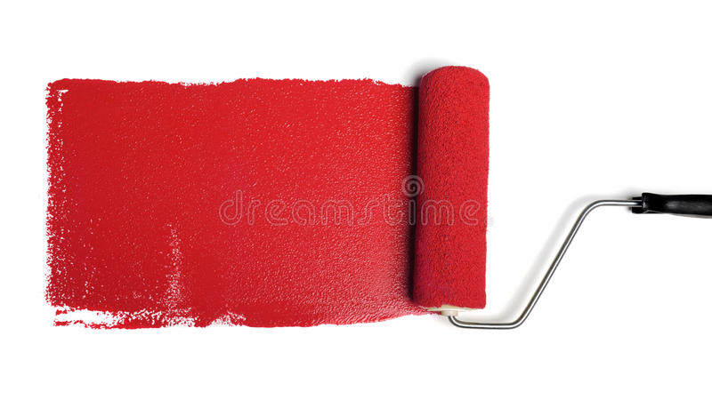 Rolo de pintura com pintura vermelha fotografia de stock