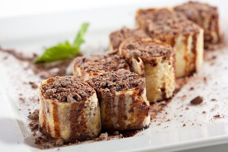 Rolo de sushi do chocolate fotos de stock