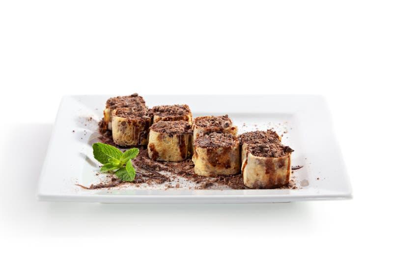 Rolo de sushi do chocolate imagens de stock royalty free