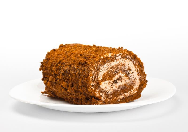 Rolo do chocolate no prato branco imagem de stock royalty free