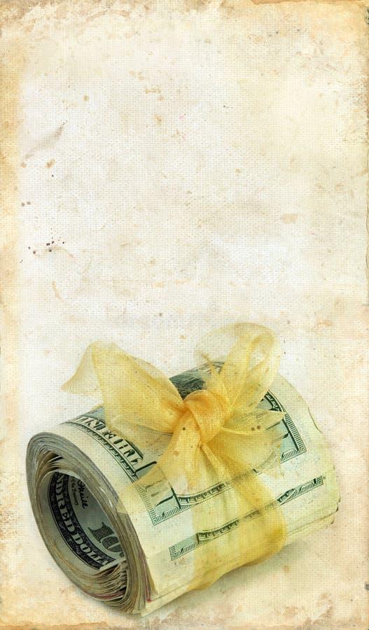 Rolo do dinheiro em um fundo de Grunge imagens de stock