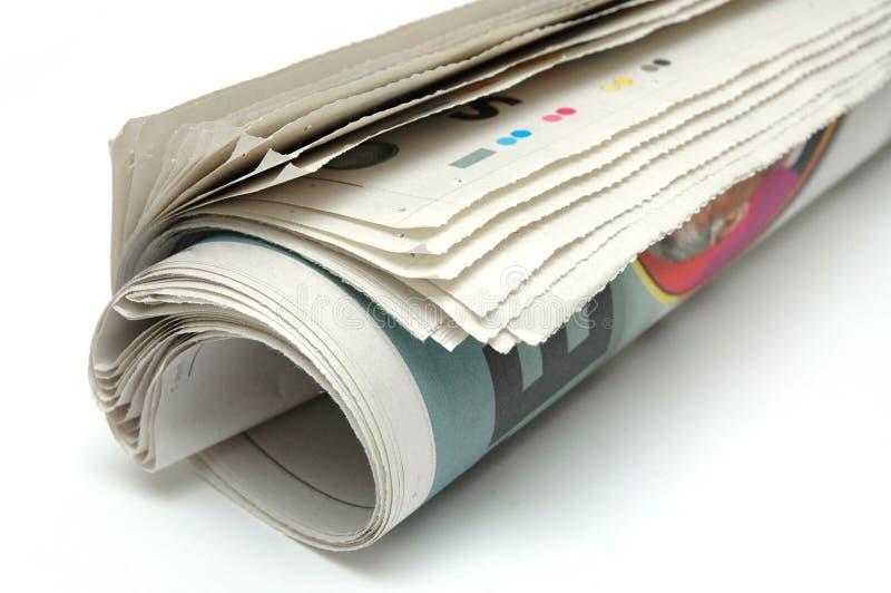 Rolo do jornal fotografia de stock