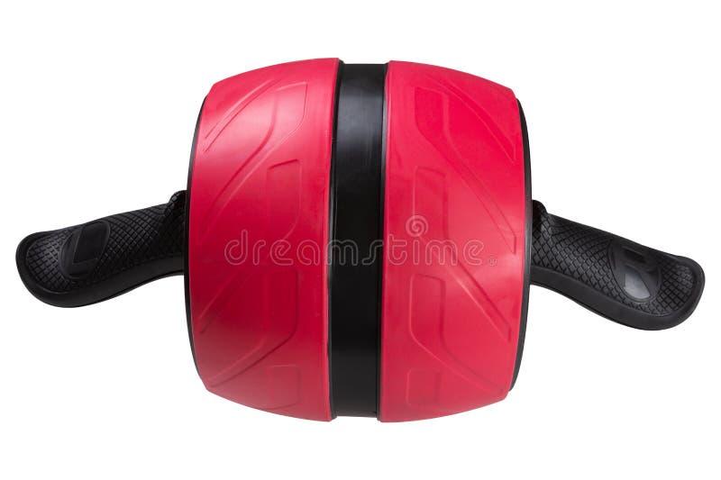 Rolo grande vermelho da aptidão, com mola com inércia, para treinar os músculos abdominais e para trás, em um fundo branco imagens de stock royalty free