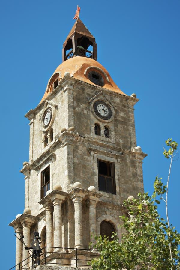 Roloi clocktower closeup. Roloi clocktower with knight in the Rodos, Greece closeup photo stock photo