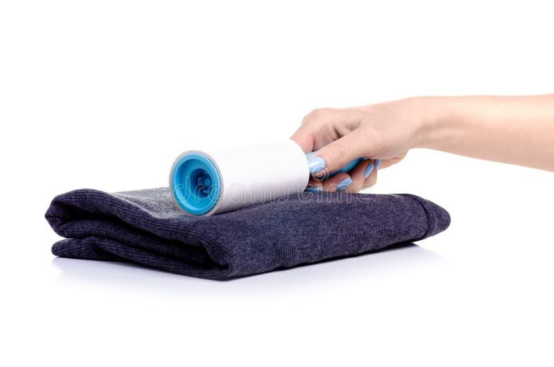 Rolownik dla czyścić odziewa w ręce fotografia stock