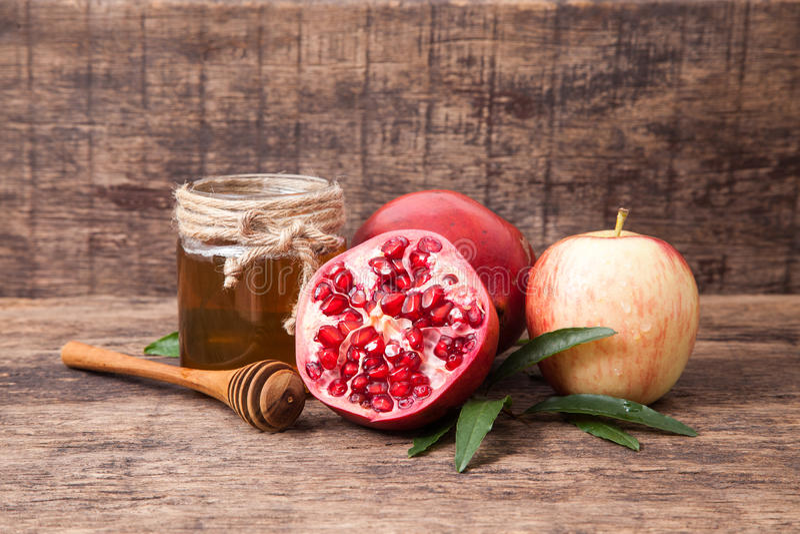 Romã, maçã e mel para o explorador de saída de quadriculação tradicional dos símbolos do feriado foto de stock