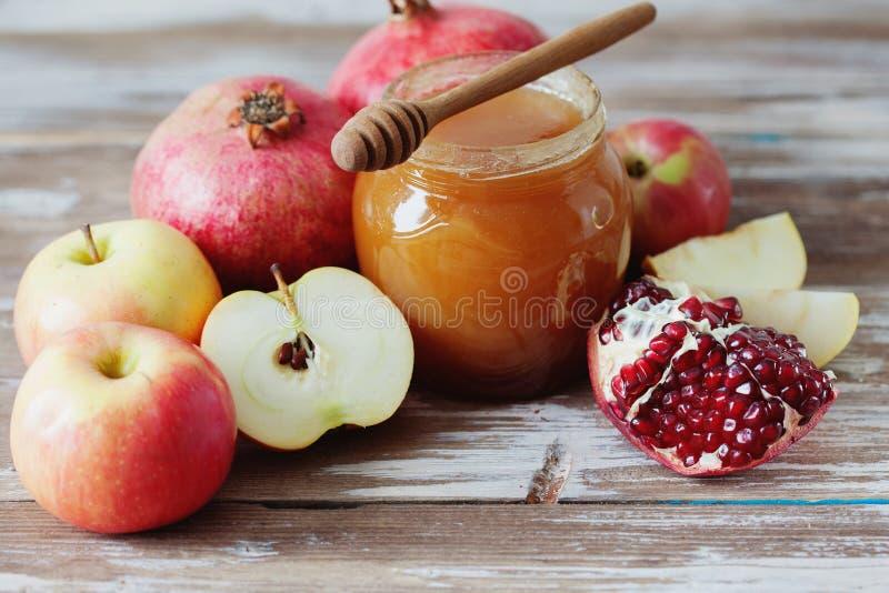 Romã, mel e maçã fotos de stock