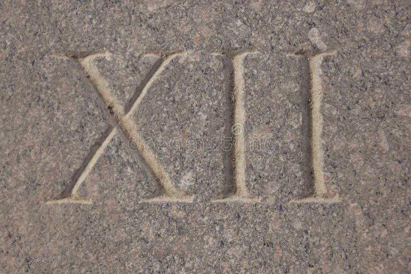 Romański liczebnik - dwanaście rzeźbiący w kamieniu zdjęcie royalty free