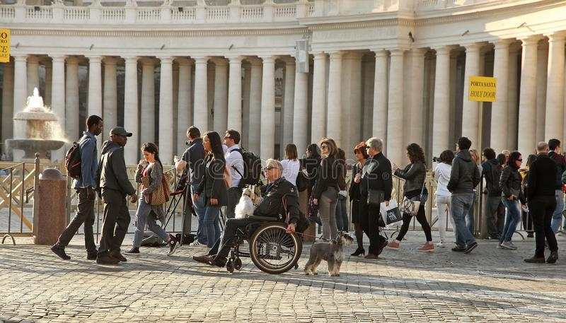 Rome, Italy - APRIL 10, 2016: Tourists are visiting St. Peter's Basilica in the Vatican. St. Peter's Basilica is one of royalty free stock images