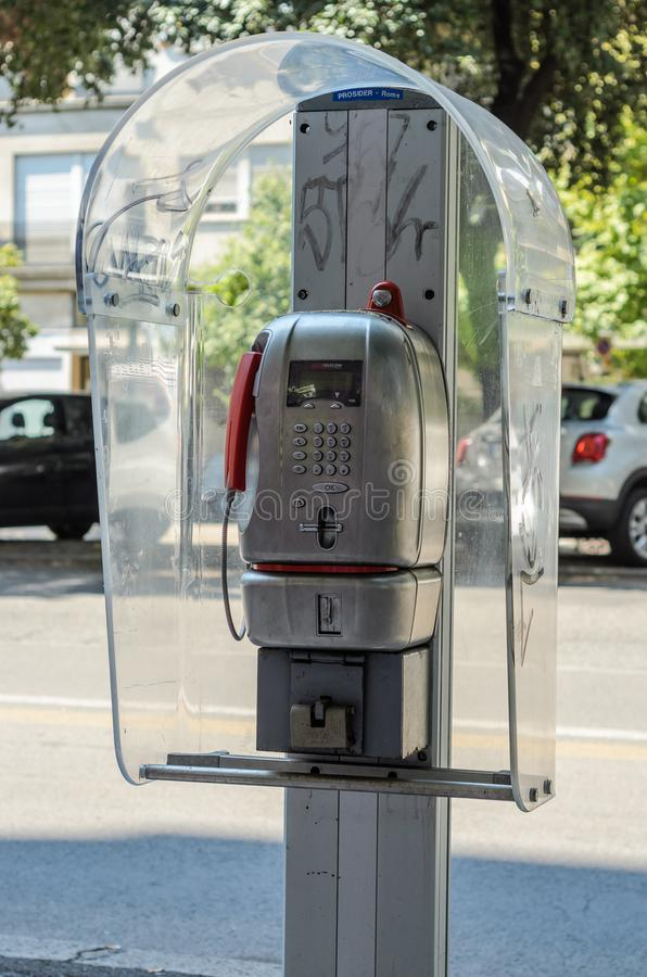ROMA, ITALY - AUGUST 2018: Telephone booth with telephone Telecom Italia well on the street Rome stock photo