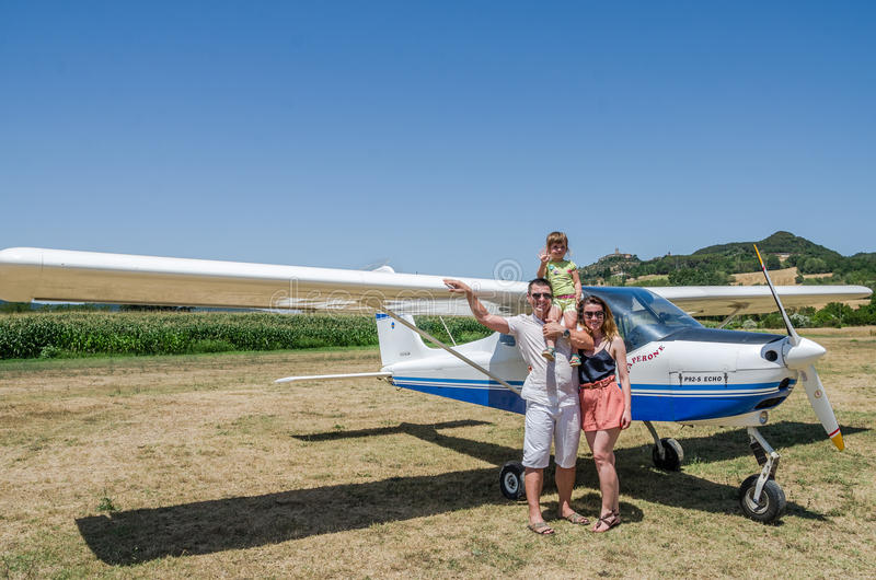 ROMA, ITALY - JULY 2017: A young family father, mother and daughter in the cabin of a light aircraft Tecnam P92-S Echo royalty free stock photography
