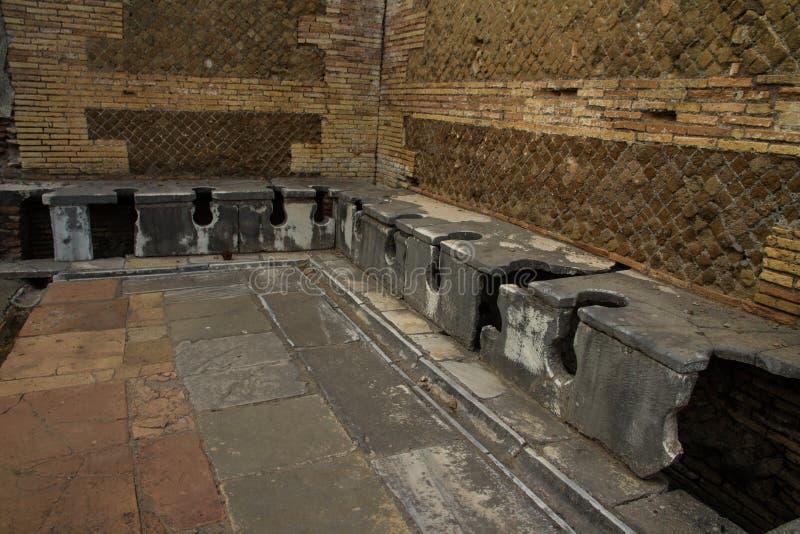 Roma latrines Ostia Antica Italy. Roman public lavatories, at Ostia Antica, roman city. Rome in Italy royalty free stock photo