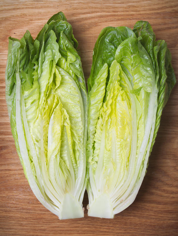 Romaine lettuce. On kitchen board stock image