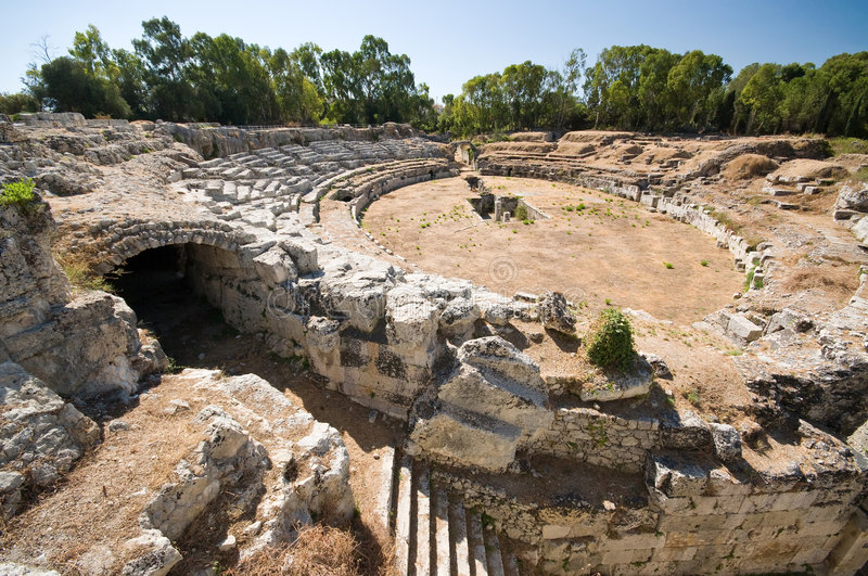 The Roman Amphitheater. Location of many gladiator fights. Located in Siracusa, Italy royalty free stock photo