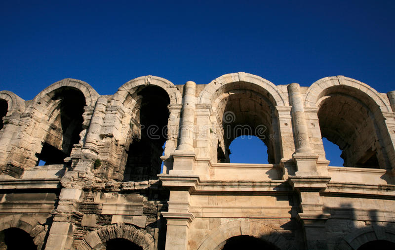 Roman amphitheater / Arena of Arles, France. Rivaled only by the Roman amphitheater in Nîmes, the Arènes (Arena, or Amphitheater) dominates old Arles. It stock images