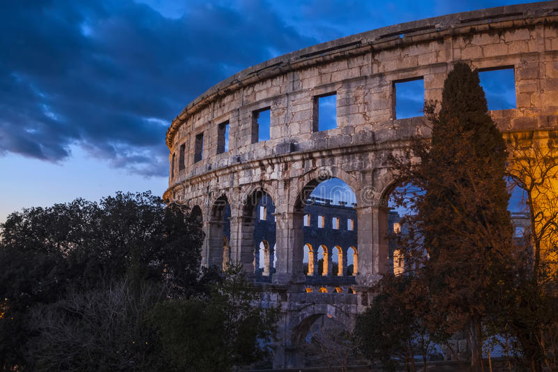The Roman Amphitheater of Pula, Croatia. Shot at dusk. It was constructed in 27 - 68 AD and is among the six largest surviving Roman arenas in the World and stock photo