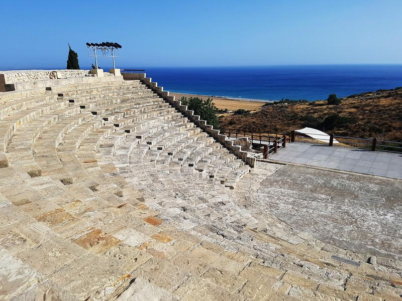 Roman amphitheater stairs from above on mediterranean coast royalty free stock images