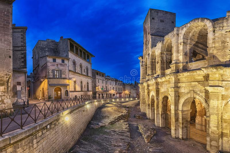 Roman amphitheatre at dusk in Arles, France royalty free stock photo