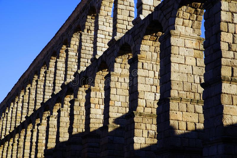 The Roman aqueduct of Segovia - the most important architectural landmark of Segovia. The Aqueduct of Segovia or more accurately, the aqueduct bridge is a Roman royalty free stock image