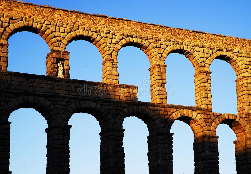 The Roman aqueduct of Segovia - the most important architectural landmark of Segovia. The Aqueduct of Segovia or more accurately, the aqueduct bridge is a Roman royalty free stock photography