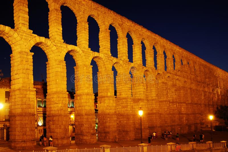The Roman aqueduct of Segovia at night - the most important architectural landmark of Segovia. The Aqueduct of Segovia or more accurately, the aqueduct bridge is stock photography