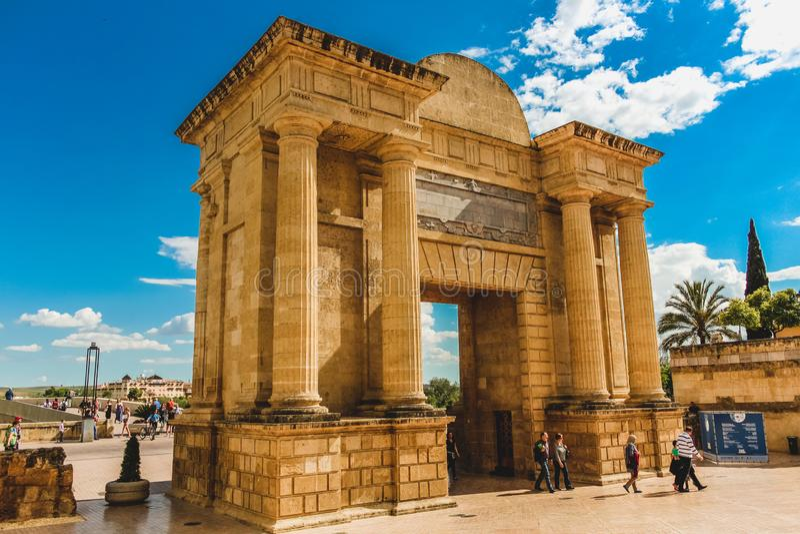 Roman arch bridge gate in Cordoba Spain royalty free stock images