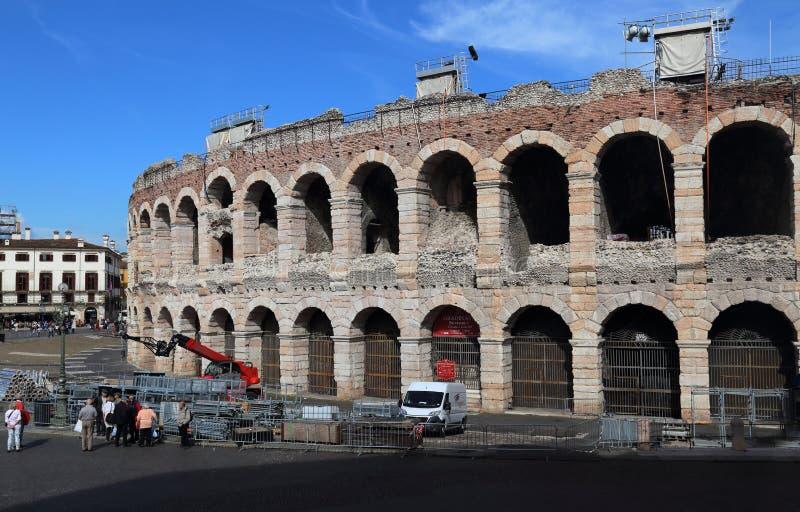 Roman arena in Verona, Italy. Verona, Italy - October 2, 2018: Roman arena and tourists on the Piazza Bra, the town square of Verona, in Verona, Italy on October stock photos