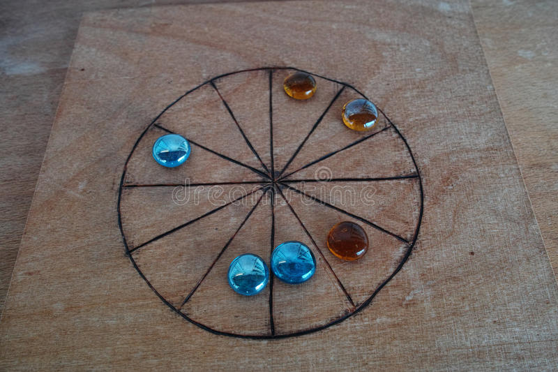 Roman board game Rota. A Roman board game with its playing stones on a table. A replicated scene which games Romans played stock photo