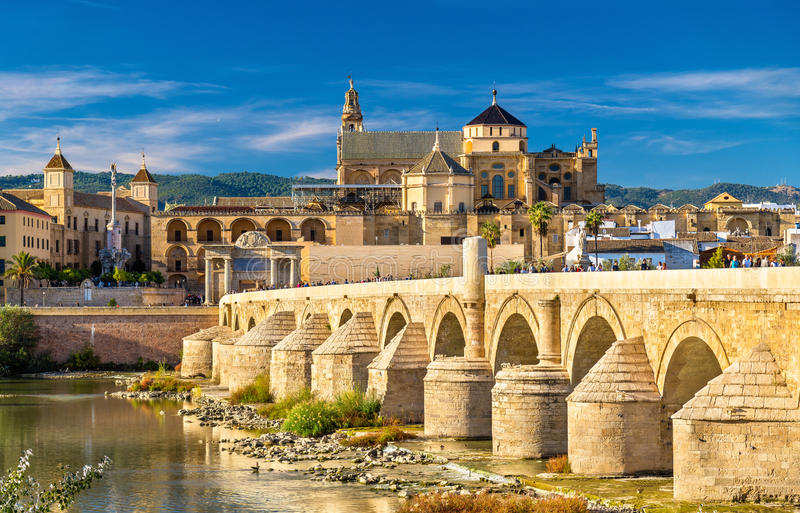 Roman Bridge across the Guadalquivir river and Mosque-Cathedral in Cordoba, Spain. The Roman Bridge across the Guadalquivir river and the Mosque-Cathedral in stock photo