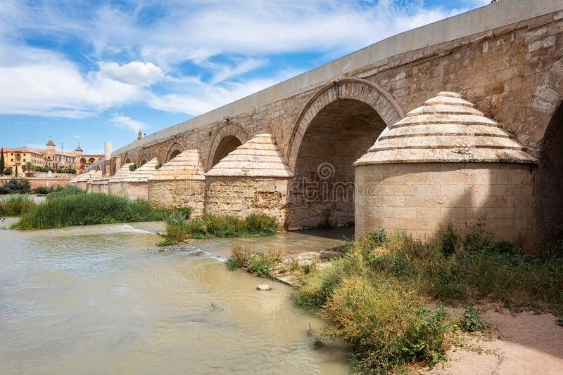 The Roman Bridge with the Cathedral-Mosque of Cordoba in the background. Andalusia, Spain stock photography