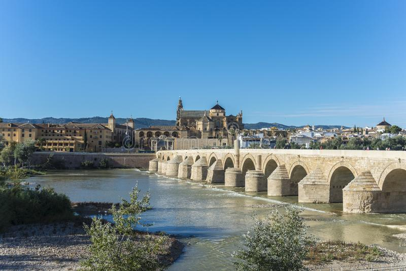 Roman bridge in Cordoba, Andalusia, southern Spain. CORDOBA, ES - OCTOBER 30, 2013: The Roman bridge, built in the early 1st century BC across the Guadalquivir stock photos