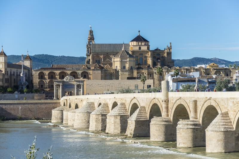 Roman bridge in Cordoba, Andalusia, southern Spain. CORDOBA, ES - OCTOBER 30, 2013: The Roman bridge, built in the early 1st century BC across the Guadalquivir stock images