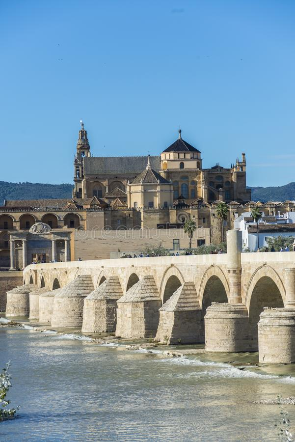 Roman bridge in Cordoba, Andalusia, southern Spain. CORDOBA, ES - OCTOBER 30, 2013: The Roman bridge, built in the early 1st century BC across the Guadalquivir stock image