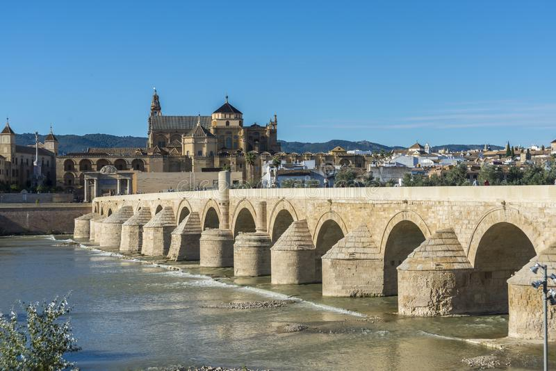 Roman bridge in Cordoba, Andalusia, southern Spain. CORDOBA, ES - OCTOBER 30, 2013: The Roman bridge, built in the early 1st century BC across the Guadalquivir royalty free stock photos