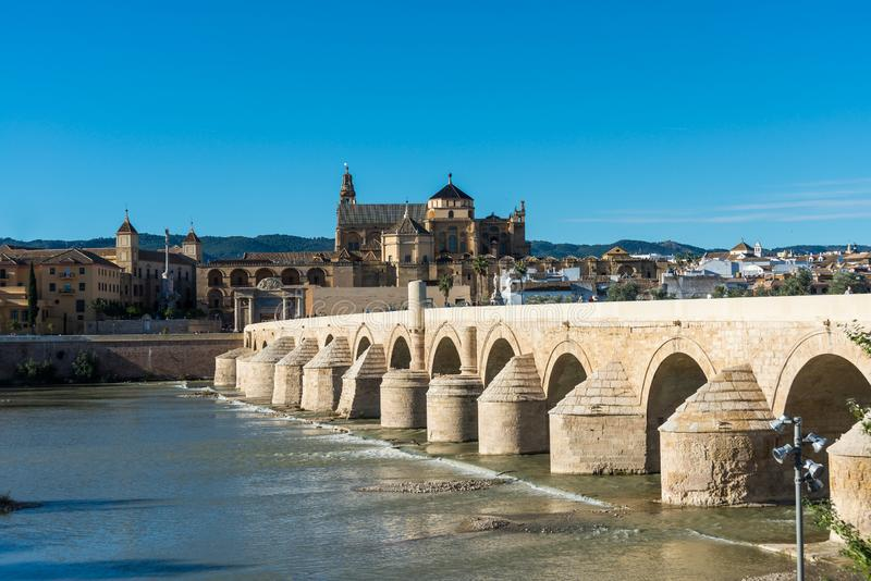 Roman bridge in Cordoba, Andalusia, southern Spain. CORDOBA, ES - OCTOBER 30, 2013: The Roman bridge, built in the early 1st century BC across the Guadalquivir royalty free stock photography