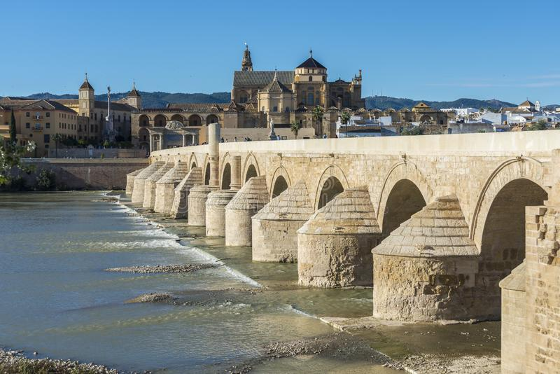 Roman bridge in Cordoba, Andalusia, southern Spain. CORDOBA, ES - OCTOBER 30, 2013: The Roman bridge, built in the early 1st century BC across the Guadalquivir stock photography