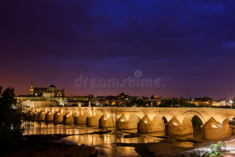 Roman Bridge in Cordoba at Night. Spain, city of Cordoba, Roman Bridge Puente Romano on Guadalquivir River at night royalty free stock photos