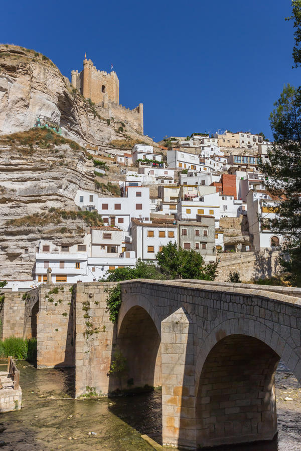 Roman bridge leading to Alcala del Jucar. Spain stock photos